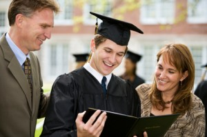 Parents and male student at college graduation